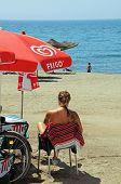 Woman on beach, Malaga, Spain.
