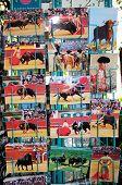 Bullfighting cards in rack, Malaga, Spain.