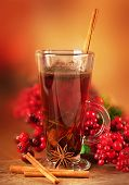 Mulled wine from wine and cinnamon a Christmas branch of berries