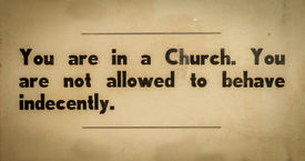 stock photo of indecent  - Old VIntage Sign In A Church Asking Visitors To Behave Respectfully - JPG