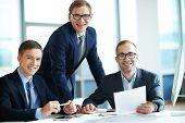 Three businessmen smiling at camera