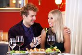 Smiling Young Couple - Guy Feeding His Partner