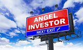 Angel Investor Inscription on Red Billboard.