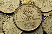 Coins of Greece. The Vergina Sun also known as the Macedonian Star depicted in the old Greek 100 drachma coin.