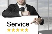 Businessman Pointing On Sign Service