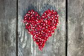pomegranate macro seeds in heart shape