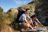 foto of lost love  - couple lost on hiking trail with backpack and map - JPG