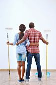 Young black couple ready to paint their new home apartment together