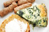 Close-up Of A Delicious Brunch Of Quiche, Toast And Sausage