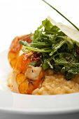Risotto with Tiger Prawns and Rucola. Served with Parmesan Chip