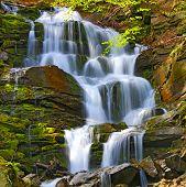 Scene with nice waterfall in Carpathians