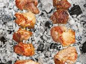 Shish Kebab On Metal Skewers Over Charcoal With Ash