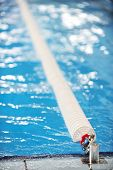 stock photo of divider  - Detail with a olympic swimming pool lane divider system - JPG