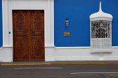Door in Blue Building