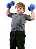 Isolated Portrait Of Elementary Age Boy With Dumbbells Exercising