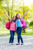 Happy Teenage Schoolgirls With Schoolbag