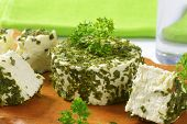 fresh chives cheese on wooden cutting board