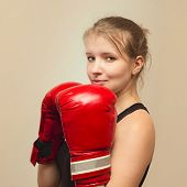 beautiful young athletic woman in boxing gloves