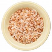 Himalayan salt coarse crystals in a ceramic bowl isolated on white