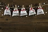Wooden christmas background: greeting card with presents and text.