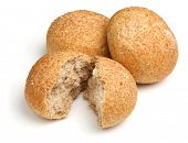 Wholewheat bread rolls on white background