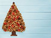 foto of hazelnut tree  - Christmas tree made of nuts cinnamon and anise - JPG
