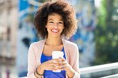 stock photo of afro hair  - Afro woman with coffee to go  - JPG