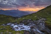 A Mountain Stream On A Background Of A Beautiful Sunset