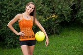 Beautiful Young Woman Playing With Ball Outdoor In Park