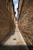 Narrow lane in old town of Toledo, Spain