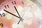 Clock face, calendar and abstract background