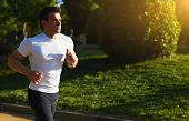 Male runner doing workout outdoors,young man running