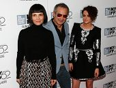 NEW YORK-OCT 8: Juliette Binoche (L), director Olivier Assayas & Kristen Stewart (R) attend the