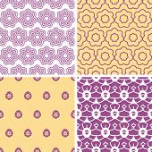 Four abstract purple and gold oriental motives seamless patterns set