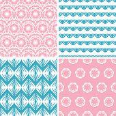 Four abstract pink blue folk motives seamless patterns set