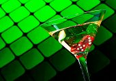 Red Dice In The Cocktail Glass On Blur Green