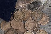 Bag Of Vintage Coins On Old Wood