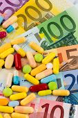 euro banknotes and tablets, symbol photo for costs of medications and health insurance.