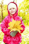 girl with a bouquet of maple leaves