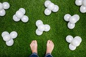 Mens Feet Standing On Grass With White Baloons