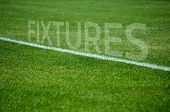 Football fixtures text on grass with white lane