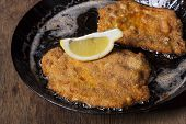 image of wieners  - wiener schnitzel in a pan on wood - JPG