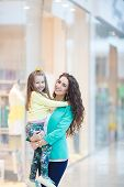 Young mother and her daughter doing shopping together
