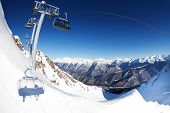 foto of ropeway  - Chair lift and ropeway panorama on top of the mountain range on ski resort in Sochi - JPG