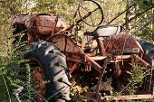Rusty Old Red Tractor in Junkyard