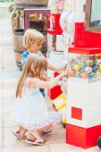 Kids buying toys in a toy machine