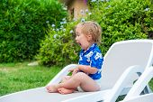 Adorable toddler boy playing outdoors