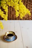 image of mimosa  - Cup of coffee on wooden table and mimosa - JPG