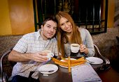 foto of churros  - young beautiful American tourist couple having spanish typical breakfast hot chocolate with churros smiling happy in tourism and holidays travel in Europe concept - JPG
