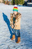 Winter portrait of a cute little girl